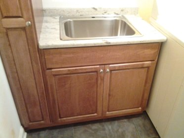 Laundry Room Broom Closet Maple Cherry Stain Vanity Sink Clothe Rack Rod Cabinet Cabinets Storage